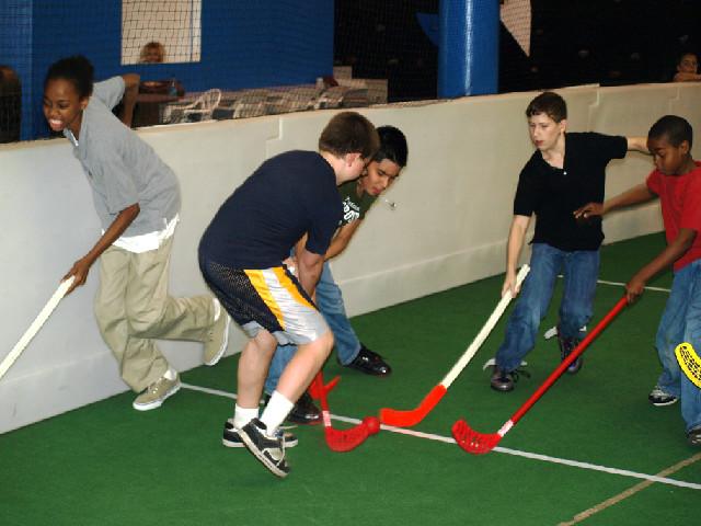 all sports kids floor hockey game on turf
