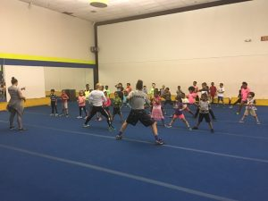 all sports kids coach teaching karate