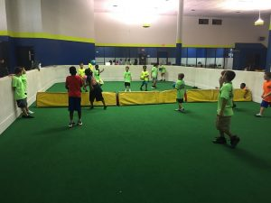 all sports kids playing indoor dodgeball