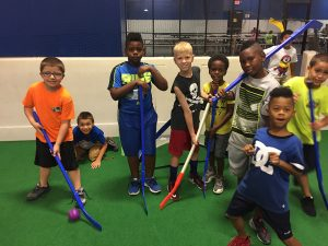 all sports kids smiling playing hockey